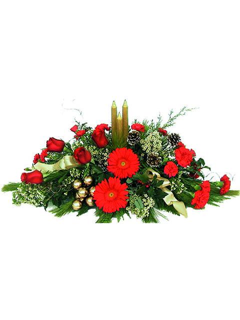 Centrotavola di gerbere rosse e candele